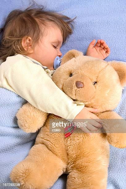 Kid slipping with Teddy Bear