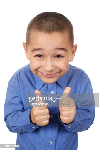 kid smiling giving thumbs up : Stock Photo