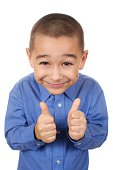 six year old boy smiling giving thumbs up sign, isolated on white background