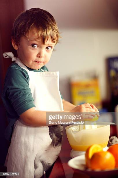 kid squeezing oranges
