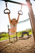 Kid swinging at playground.