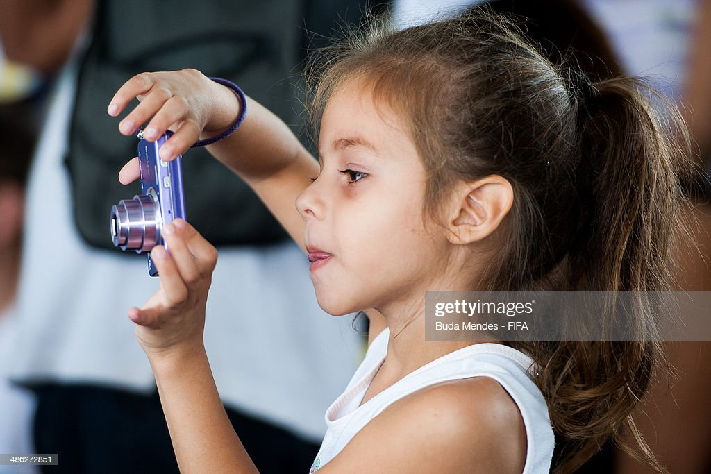 A kid takes photos during visit the FIFA 11 for Health Program as part of the 2014 FIFA World Cup Host City Tour on April 23, 2014 in Cuiaba, Brazil