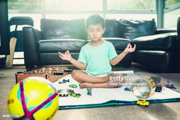Kid trying to calm himself in room.