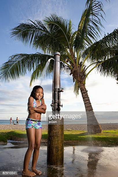Kid under beach shower