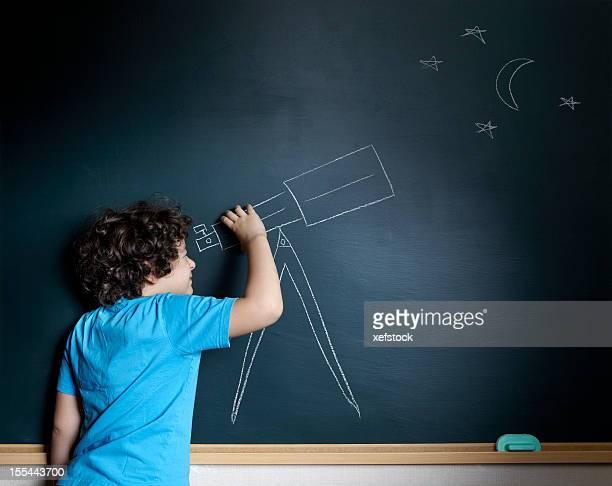 A kid using his imagination to look at stars