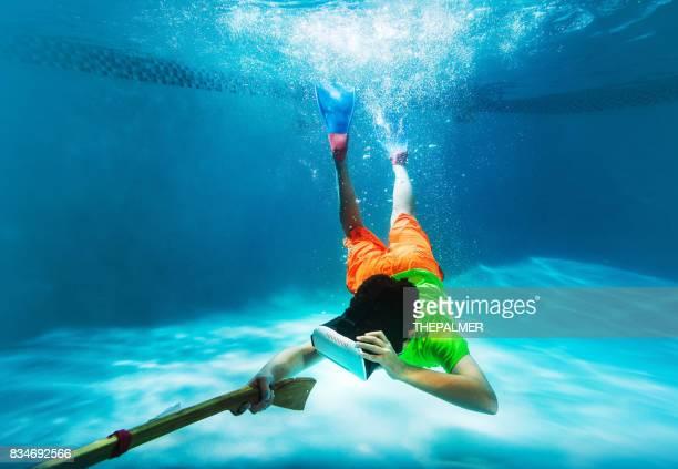 Kid using VR googles on a pool