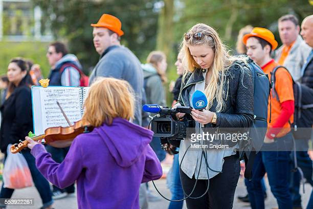 Kid violin player being recorded for TV