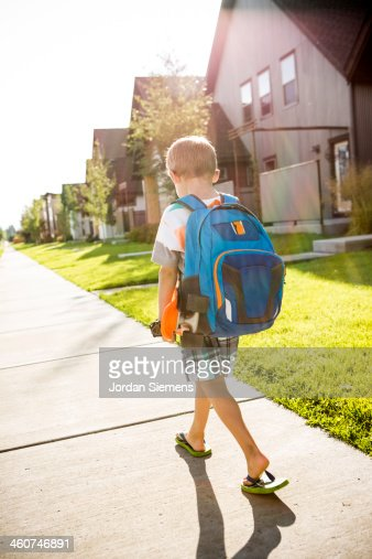 Kid walking to school.