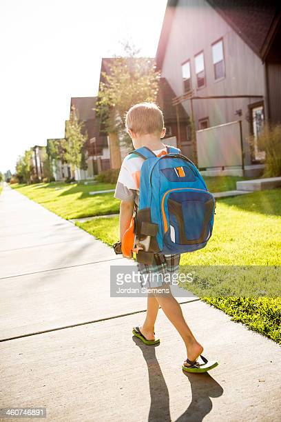 Kid walking to school.