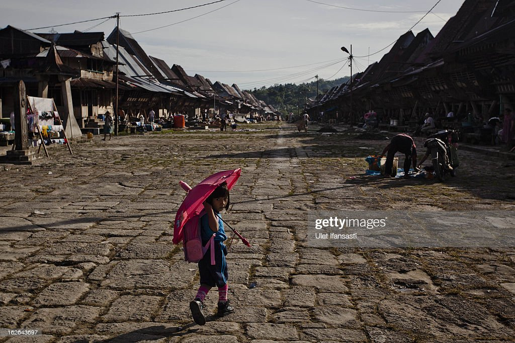 A kid walks in Bawomataluwo village on February 22, 2013 in Nias Island, Indonesia. Some of historians and archaeologists estimated this is one of remaining Megalithic cultures in existence today. Stone Jumping is a traditional ritual, with locals leaping over large stone towers, which in the past resulted in serious injury and death. Stone jumping in Nias Island was originally a tradition born of the habit of inter tribal fighting on the island of Nias.