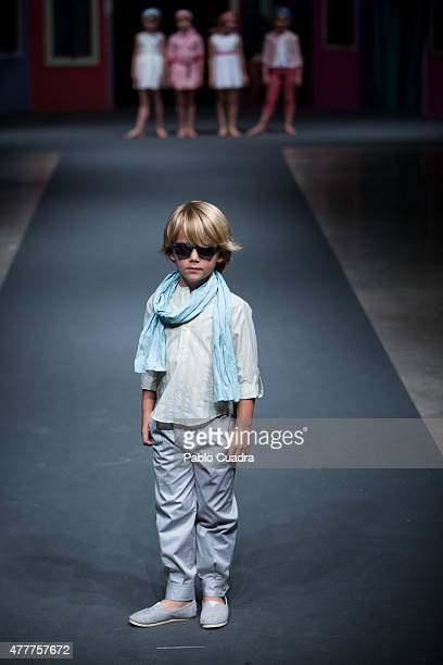 A kid walks the runway at the Nieves Alvarez show during the International Fair of Children's Fashion on June 19 2015 in Madrid Spain