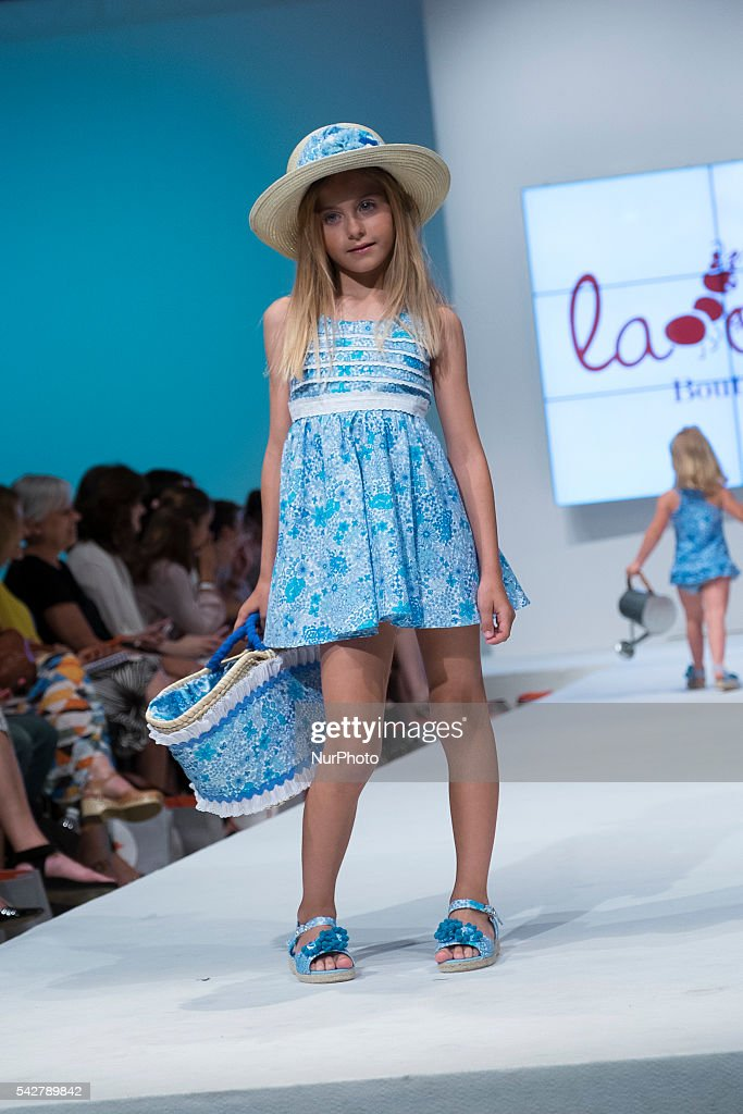 A kid walks the runway during the FIMI 2016 Fashion Show at 'Palacio de Cristal' on June 24, 2016 in Madrid, Spain.