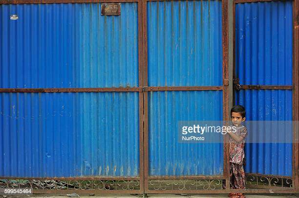 A Kid watching from gate as Hindu devotees lining to offer ritual prayer at the Rishishwor Mahadev Temple during Rishi Panchami Festival celebrations...