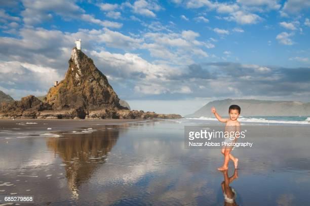 Kid Wearing Diaper Enjoying On Beach.