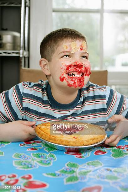 Kid with Face Covered in Pie