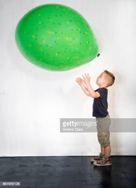Kid with huge baloon