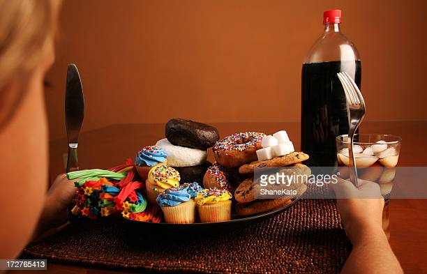Kid with plate full of Sugar, Donuts,Candy, and Soda