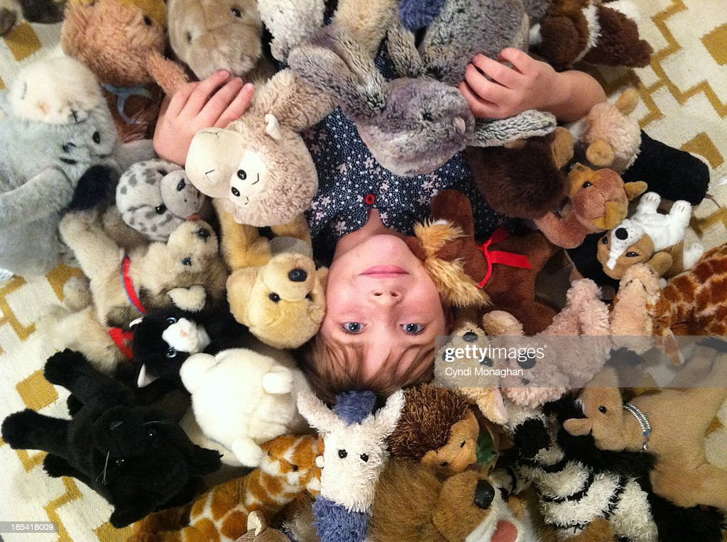 Kid with stuffed animals