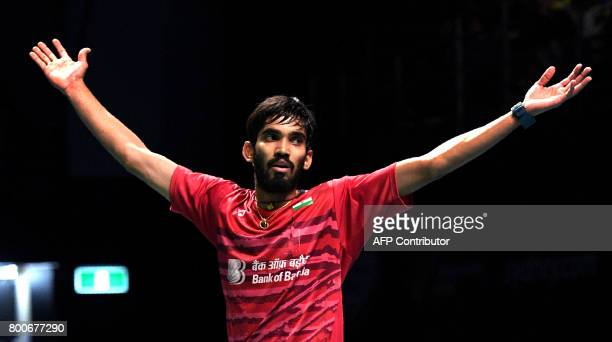 Kidambi Srikanth of India celebrates after defeating Chen Long of China in the Australian Open men's singles badminton final in Sydney on June 25...