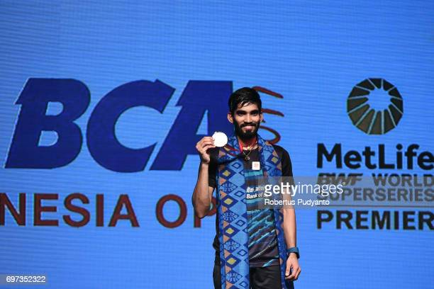 Kidambi Srikanth of India celebrates on the podium during Men's Single medals ceremony of the BCA Indonesia Open 2017 at Plenary Hall Jakarta...