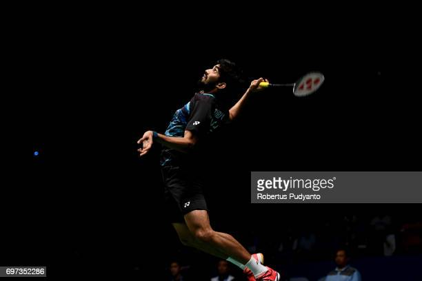 Kidambi Srikanth of India competes against Kazumasa Sakai of Japan during Men's Single Final match of the BCA Indonesia Open 2017 at Plenary Hall...