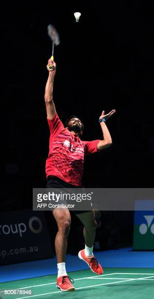 Kidambi Srikanth of India hits a return on the way to defeating Chen Long of China in the Australian Open men's singles badminton final in Sydney on...