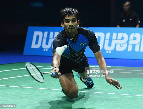 Kidambi Srikanth of India in action against Kento Momota of Japan in the Mens Singles during day one of the BWF Destination Dubai World Superseries...