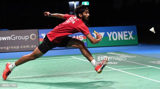 Kidambi Srikanth of India reaches for a return against Chen Long of China during the Australian Open men's singles badminton final in Sydney on June...