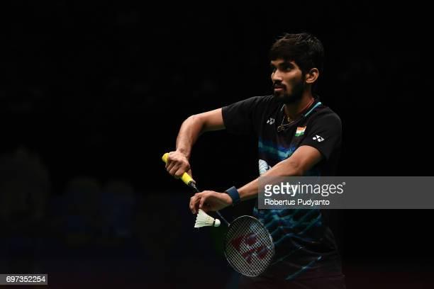 Kidambi Srikanth of India serves against Kazumasa Sakai of Japan during Men's Single Final match of the BCA Indonesia Open 2017 at Plenary Hall...