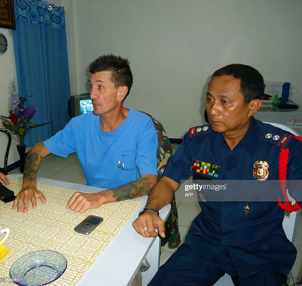Kidnapped Australian national Warren Rodwell (L) sits next to Philippine police superintendent Jilius Munez (R) at the police station in Pagadian City, in southern island of Mindanao early March 23, 2013, shortly after his release. Islamic militants in the Philippines have released Australian Warren Rodwell, more than 14 months after kidnapping him from his home in the south of the country, the military said on March 23. AFP PHOTO / Jong Cadion