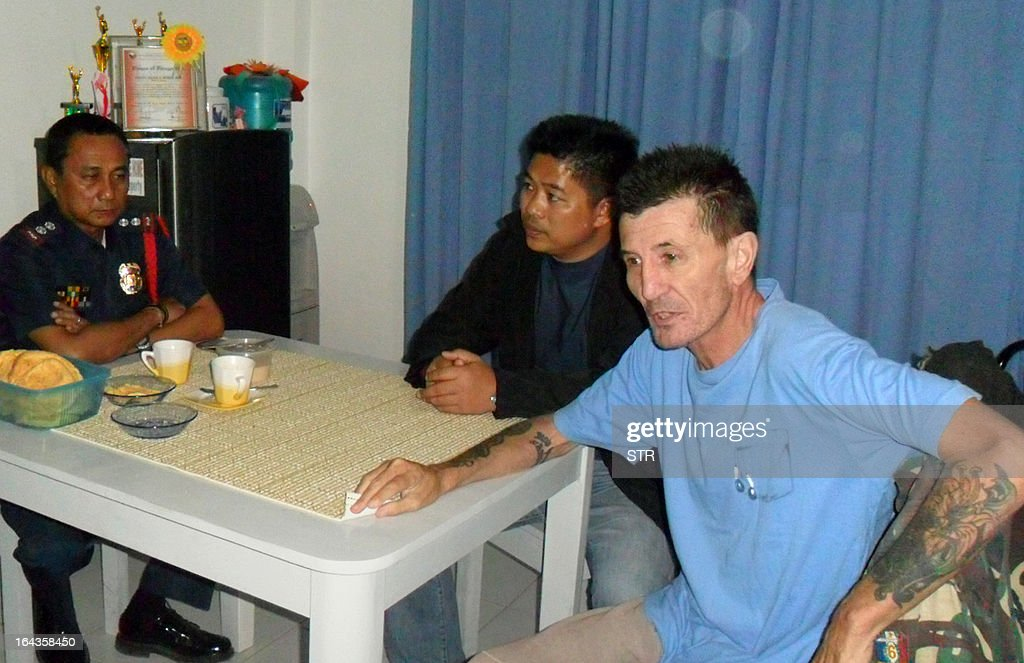 Kidnapped Australian national Warren Rodwell (R) sits next to Philippine police superintendent Jilius Munez (L) at a police station in Pagadian City, on the southern island of Mindanao early March 23, 2013, shortly after he was released by his Islamic militant kidnappers. Rodwell walked free on March 23 after being held for 15 months by Islamic militants in the lawless southern Philippines, deeply emaciated and frail but able to smile. AFP PHOTO
