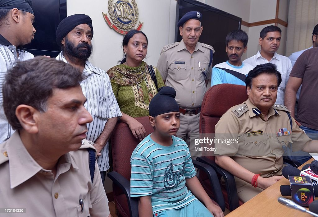 A kidnapped boy, rescued by Delhi police with his mother at Delhi Police head quarters in New Delhi on Sunday.