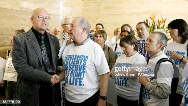 Kidney cancer sufferer Clive Stone from Freeland near Witney and radio presenter James Whale who also suffered from the disease shake hands as the...