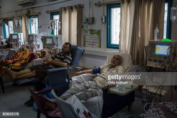 Kidney patients are seen hooked up to dialysis machines at Shifa hospital on July 19 2017 in Gaza City Gaza Dialysis machines require uninterrupted...