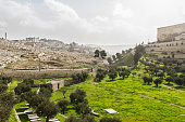 Kidron Valley. Left the Jewish cemetery on the Mount of Olives, then village of Silwan, in the center of the tomb of Absalom and right walls of Old Jerusalem.