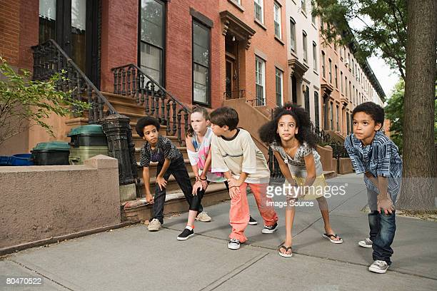 Kids about to race on sidewalk
