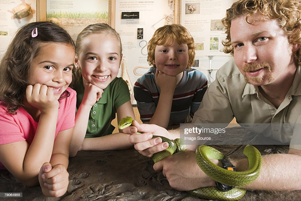Kids and zoo keeper with snake