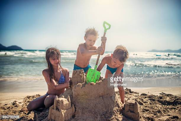 Kids are building sandcastle on a beach