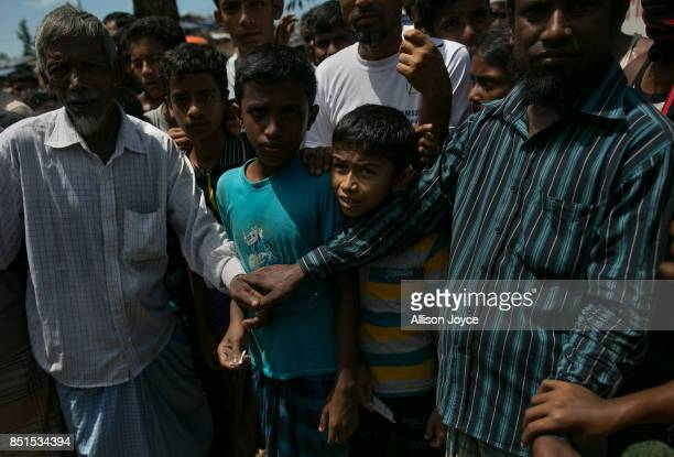 COX'S BAZAR BANGLADESH SEPTEMBER 22 Kids are seen during an aid distribution on September 22 2017 in Cox's Bazar Bangladesh Over 230000 child...