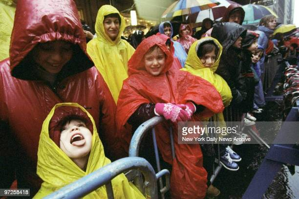 Kids are under wraps against the wet weather at the 72nd annual Macy's Thanksgiving Day Parade