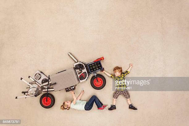 Kids assembling motor vehicle