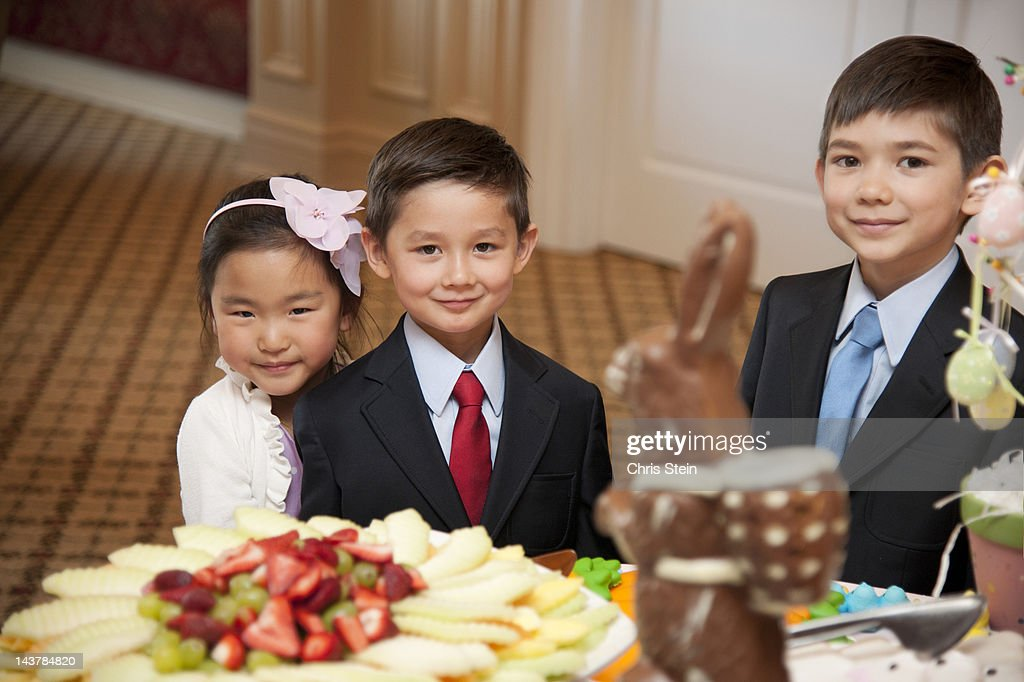 Kids at a dessert table : Stock Photo