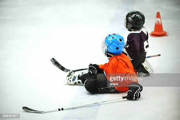 Kids at ice hockey practice.