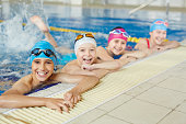 Happy group of children swimming together