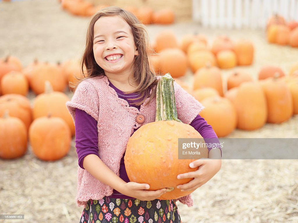 Kids at pumpkin patch : Stock Photo
