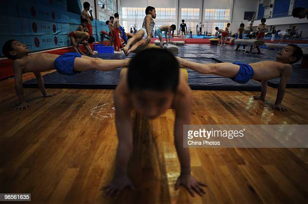Kids attend a training session during the 2010 Training Camp For Country's Reserve Gymnastic Athletes at the Gymnastic Hall of Hubei Olympic Sport...