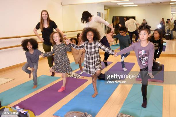 Kids attend Yoga class at Vancouver Fashion Week Fall/Winter 2017 at Chinese Cultural Centre of Greater Vancouver on March 25 2017 in Vancouver Canada