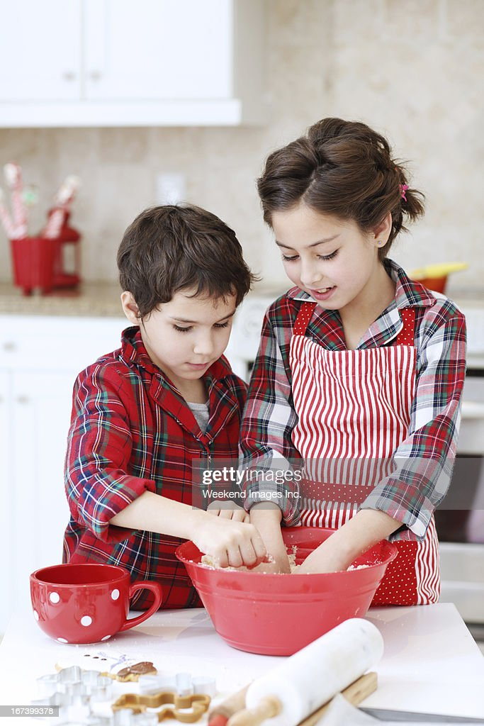 Kids baking sugar cookies : Stock Photo