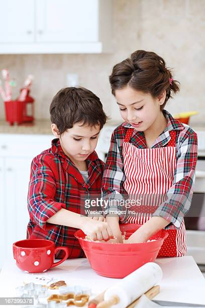 Kids baking sugar cookies