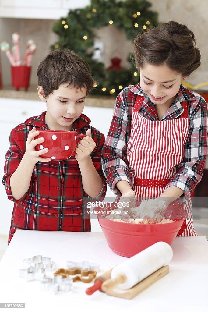 Kids baking sugar cookies : Stock Photo